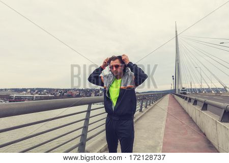 Urban jogger preparing for workout on the bridge.