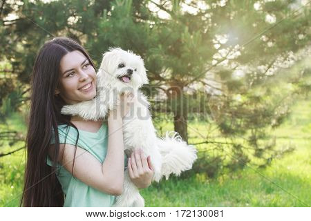 Woman Beautiful Young Happy With Long Dark Hair Holding Small Dog