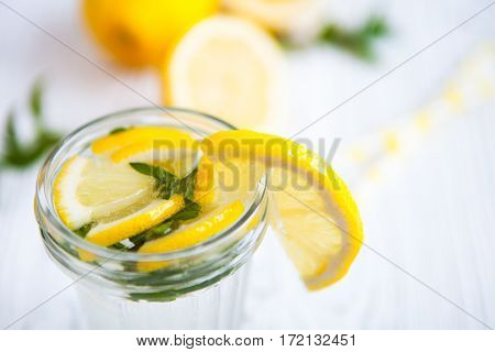 Lemonade With Fresh Lemon And Mint On White Vintage Wooden Background