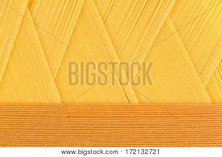 Italian long kinds spaghetti top view with copy space as decorative pasta background.