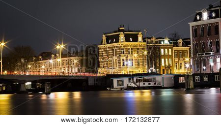 View of Amstel river in Amsterdam at night