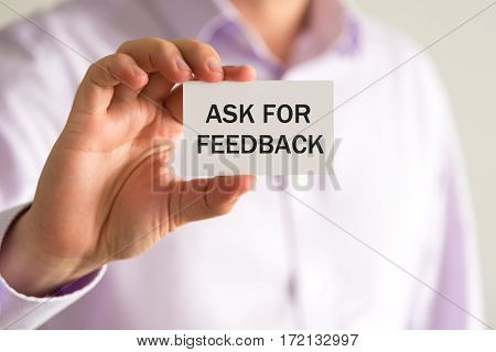 Businessman Holding Card, Text Ask For Feedback