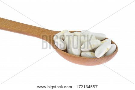 White beans isolated in wooden spoon isolated on white background