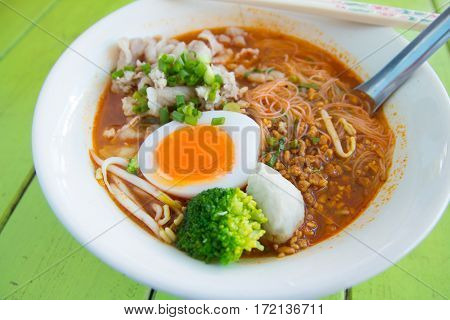 Hot and spicy noodle on the green table