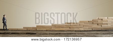 Young Successful Businessman Standing In Front Of Wooden Stairs
