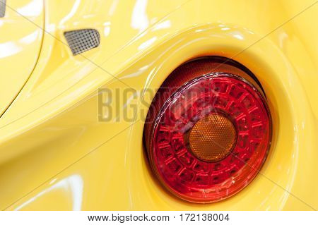 Back of a yellow sport car in the sunlight