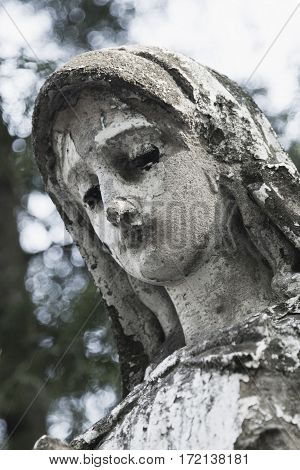 Statue of Virgin Mary as a symbol of love and kindness (antique statue)