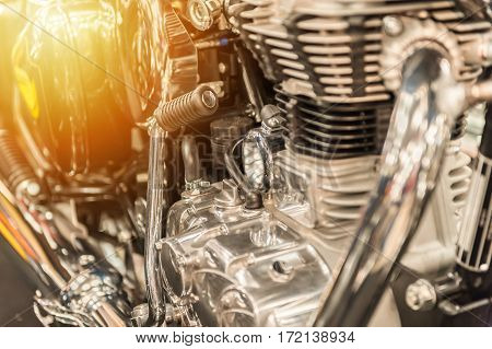 Engine of a powerful motorbike in the sunset