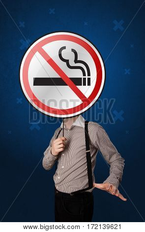 Casual businessman holding round sign with no smoking graphic