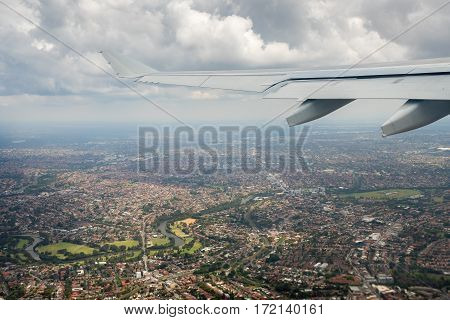Sydney, Australia - Oct 29, 2016: Moments after plane takes off from runway. Departing from Sydney Kingsford-Smith International Airport. Suburbia below.