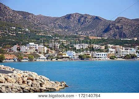 MAKRIGIALOS, CRETE - SEPTEMBER 18, 2016 - View across the sea towards the beach and town Makrigialos Crete Greece Europe, September 18, 2016.