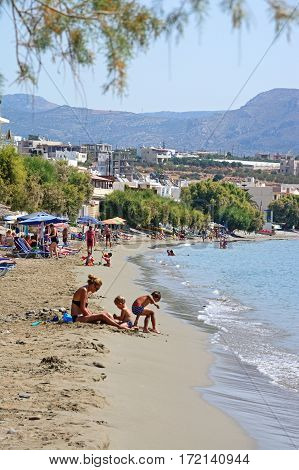 MAKRIGIALOS, CRETE - SEPTEMBER 18, 2016 - Tourists relaxing on the beach Makrigialos Crete Greece Europe, September 18, 2016.