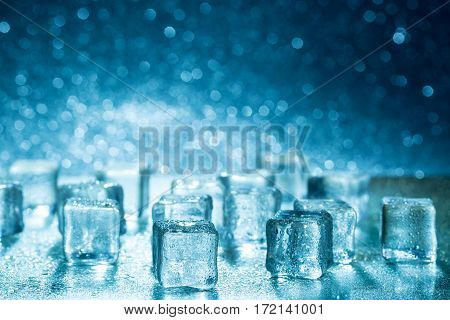 Group of melting ice cubes on glass table