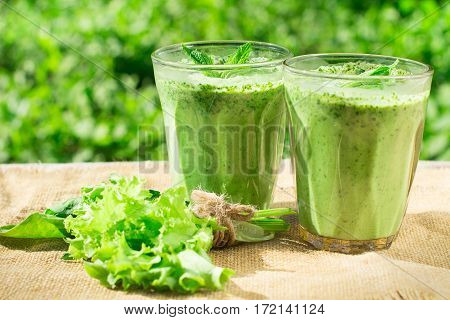 Spinach Smoothie On A Wooden Background