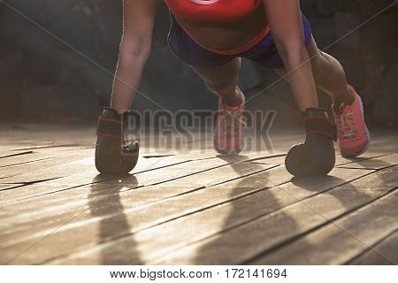 Strong young woman doing push-ups outdoors, sport and lifestyle concept
