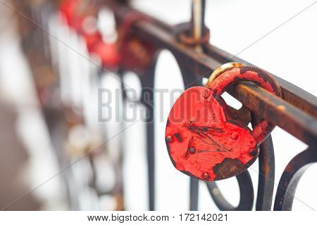 Vintage Closed Red Padlock In Heart Shape Close Up On A Blurred Background.