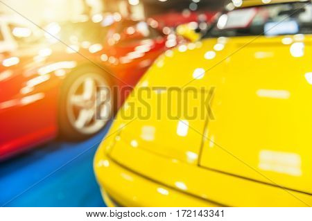 Two sport cars with defocus effect in the sunlight