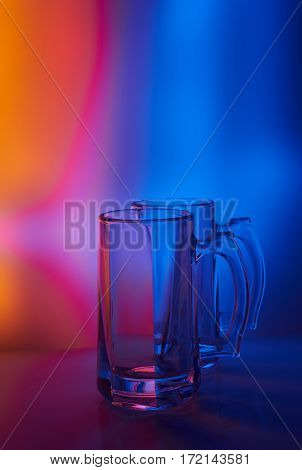 Still life. Glass wineglass of beer. Illumination through colored filters