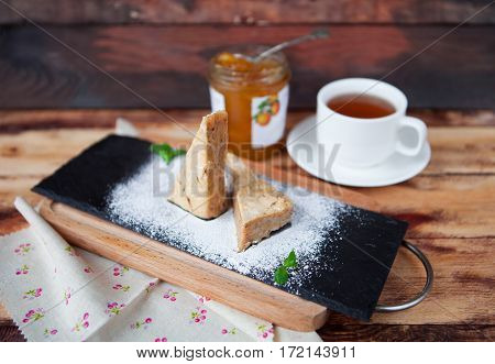 Sweet Almond Cake With Cup Of Tea On Old Wooden Background With Rustic Style