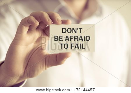 Businessman Holding Dont Be Afraid To Fail Message Card