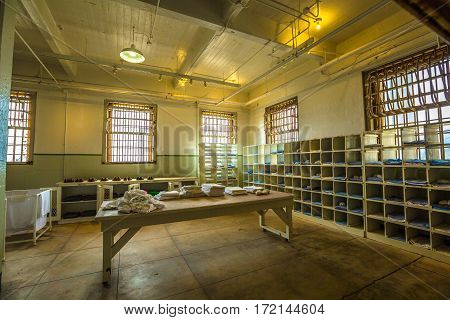 San Francisco, California, United States - August 14, 2016: Alcatraz laundry room with uniforms, linens and blankets. The Alcatraz prison are a popular tourist attraction in San Francisco.