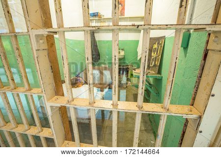 San Francisco, California, United States - August 14, 2016: Alcatraz famous cell of Clarence Anglin used in movie: Escape from Alcatraz 1989. Hole in the wall and plaster mask used on night of escape.