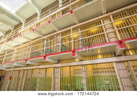 San Francisco, California, United States - August 14, 2016: inside of Alcatraz main room top cells on three levels. All the cells are single for the best control of inmates. Windows are steel barred.