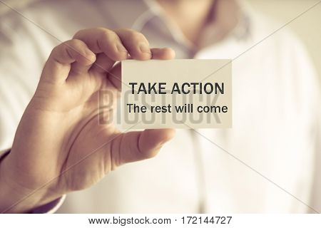 Businessman Holding Take Action The Rest Will Come Message Card