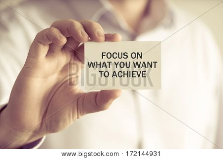 Businessman Holding Focus On What You Want To Achieve Message Card
