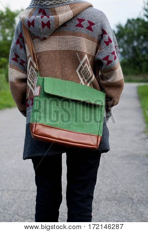 girl in a jacket with a eco bag from the back
