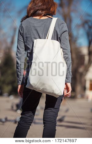 Girl with ecobag over his shoulder outdoors