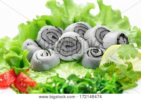 Sashimi squid, vegetables, lettuce, tomato, squid on a white background