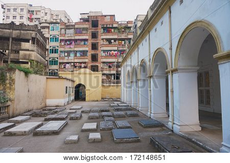 DHAKA, BANGLADESH - FEBRUARY 21, 2014: Exterior of the Armenian Apostolic Church of the Holy Resurrection and it's old grave yard in Dhaka, Bangladesh.