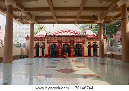 DHAKA, BANGLADESH - FEBRUARY 22, 2014: Unidentified people pray in the Dhakeshwari Hindu Temple in Dhaka, Bangladesh. It is the most important Hindu place of worship in Bangladesh.