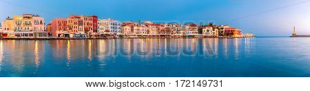 Picturesque panoramic view of old harbour with Lighthouse of Chania at sunrise, Crete, Greece
