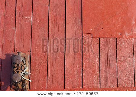 painted old wooden wall. red background in the outdoor