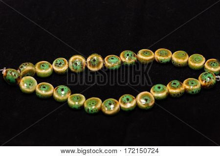 a string of green, yellow and brown beads