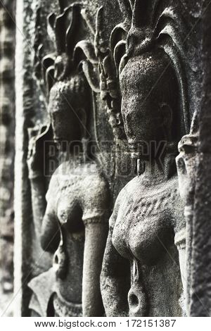 Apsara an old Khmer art carvings on the wall in Angkor Wat temple near Siem Reap town Cambodia
