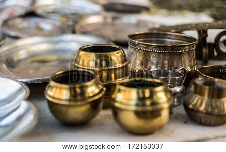 Polished old eastern copper tableware for sale as antiques