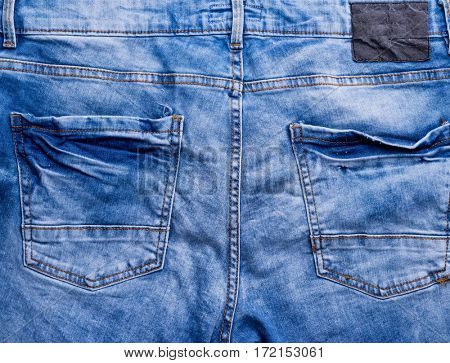 rear paft of blue male jeans with pockets, closeup
