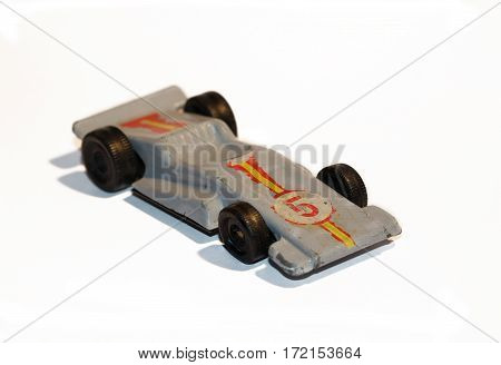An Old toy car made of metal
