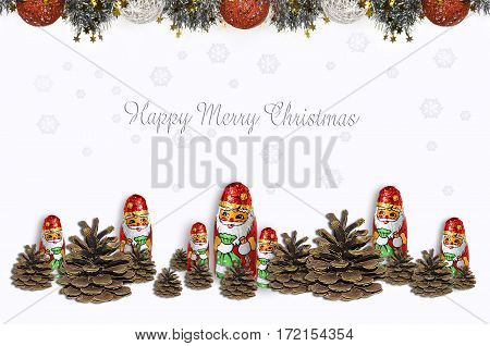 Chocolate Santa Clauses with fir cones with falling snowflakes