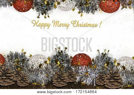 Greeting card of border with sparkles,wicker balls from yarn and Happy Merry Christmas
