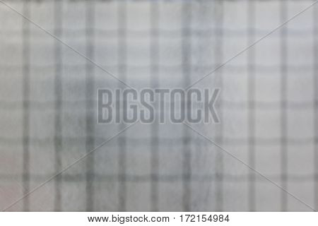Vague grey grid blurred textured black and white background
