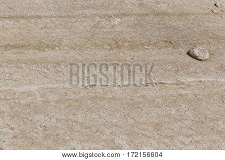 Dry arid desert yellowish brown white slope ground with rock