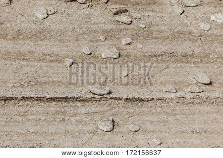 Dry arid desert yellowish brown white slope ground with stones