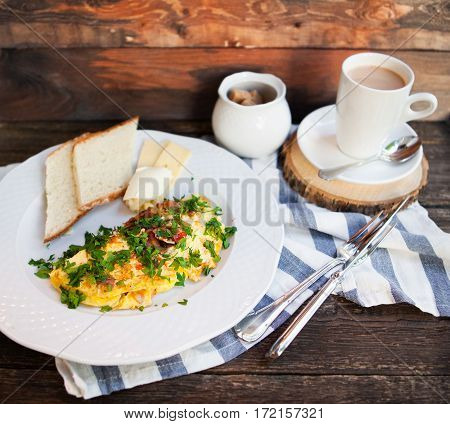 Latte Cap And Herb Omelette With Chives And Oregano Sprinkled With Chili Flakes, Garlic Panini Toast