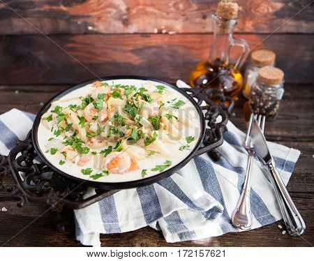 Seafood - Shrimp And Squid  With White Cream Sauce On  Frying Pan
