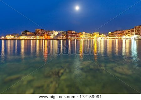 Picturesque view of Venetian quay of Chania with Kucuk Hasan Pasha Mosque at moonlit night, Crete, Greece