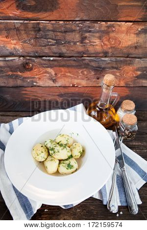 Hot Boiled Potato On Rustic Background